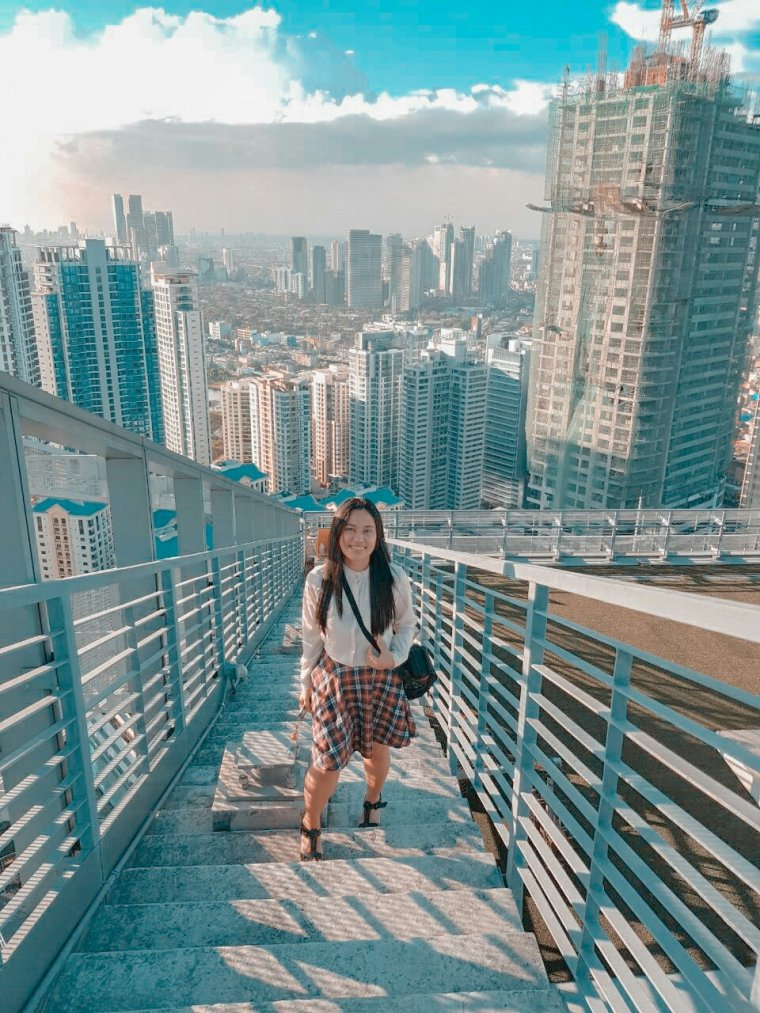 A Girl On Top of The City
