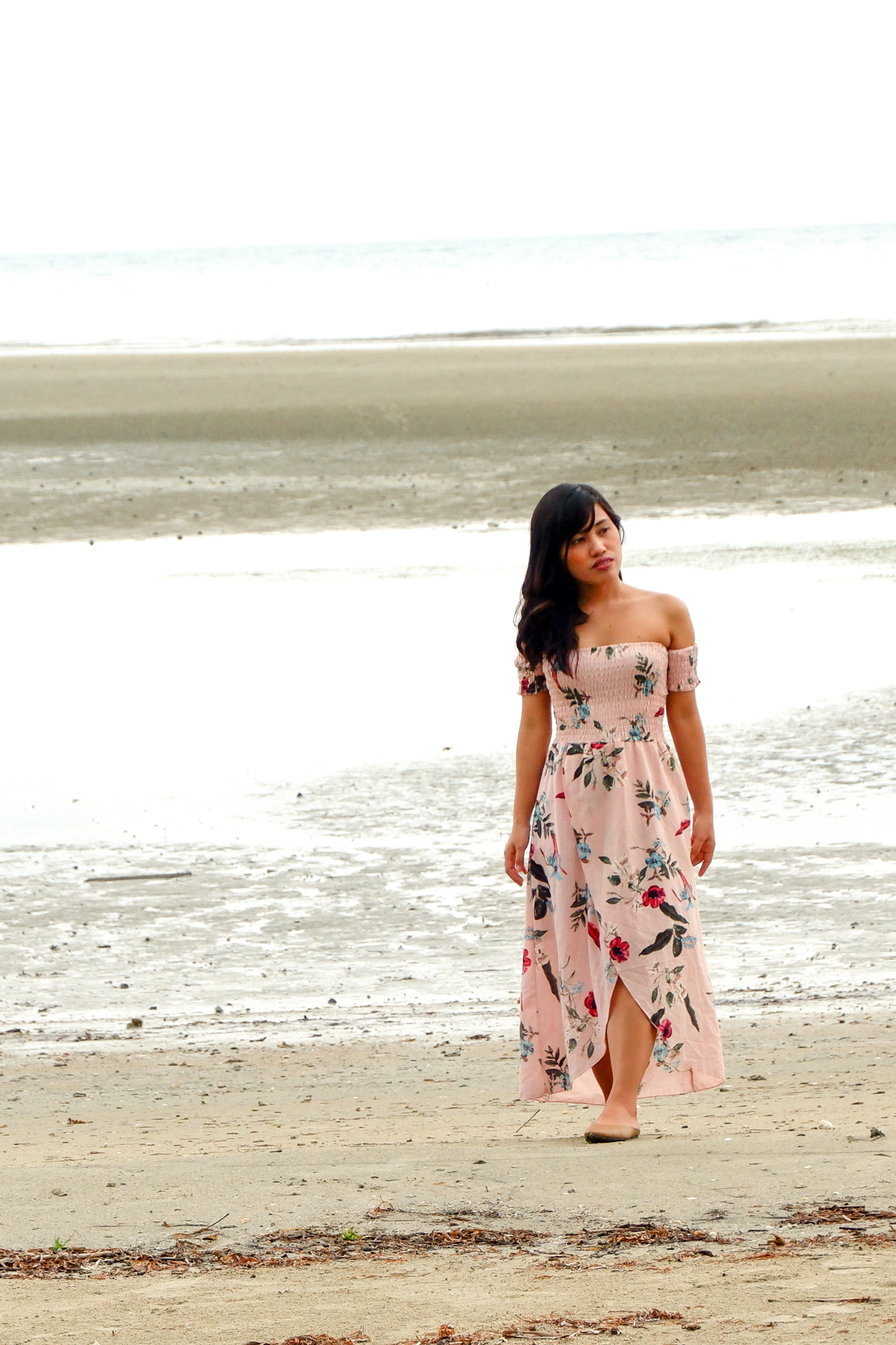 A Girl in A Pink Dress in  a Low-Tide Shore of Astoria Palawan