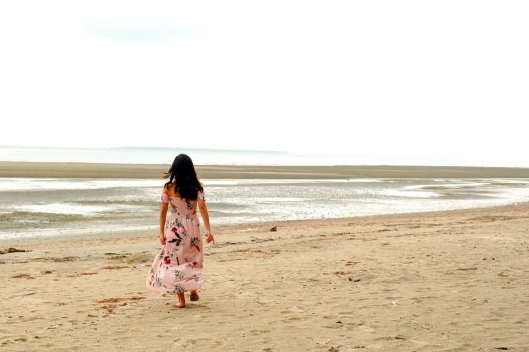 Girl in a Low -Tide Shore